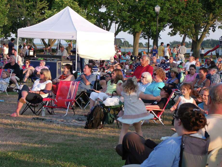 "Concert-goers enjoy the sounds of the Beatles with tribute band ""Ticket To Ride"" at the City of Norwalk Recreation and Parks Summer Concert Series Sponsored by First County Bank brings music to Calf Pasture Beach. Photo: Todd Tracy / Stamford Advocate"