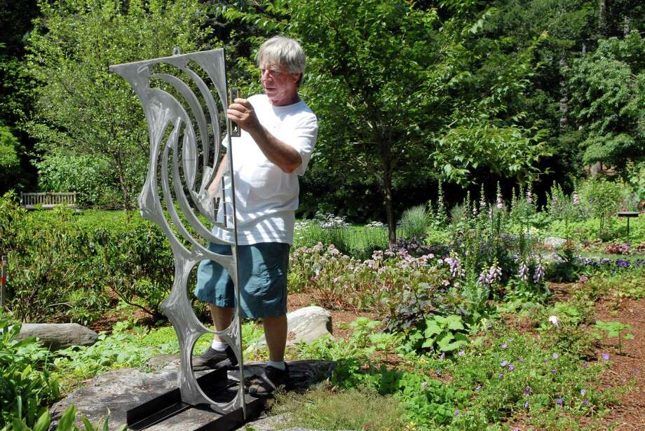 "Eric Camiel of Danbury installs his sculptue "" Nude Desending"" at the Bartlett Arboretum in Stamford, Conn. on Friday July 6, 2012, the Arboretum is running both a outdoor sculpture show and indoor exhibit called "" Flower Power"" Photo: Dru Nadler / Stamford Advocate Freelance"