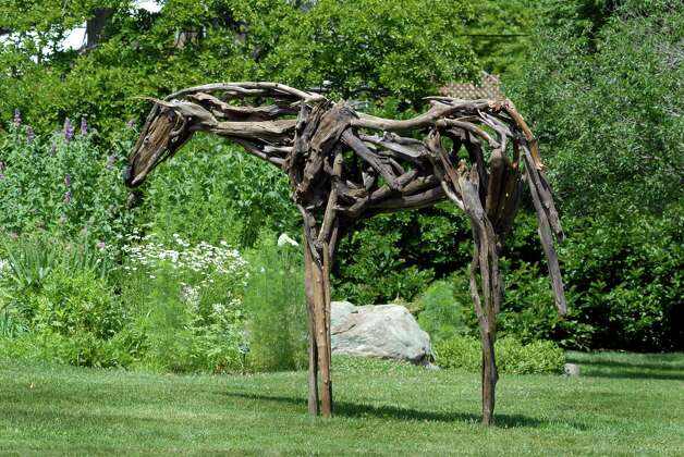 "Marcia Spivak untitled sculpture is part of a outdoor sculpture show at the Bartlett Arboretum in Stamford, Conn. on Friday July 6, 2012 where there is also a indoor exhibit called "" Flower Power"". Photo: Dru Nadler / Stamford Advocate Freelance"