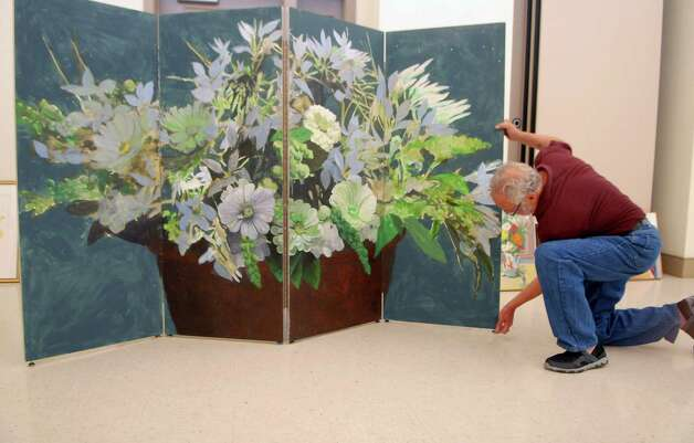 "Michael Morris of Bethel installs his art at the Bartlett Arboretum in Stamford, Conn. on Friday July 6, 2012 for a exhibit called "" Flower Power"", there is also a outdoor sculptue exhibit. Photo: Dru Nadler / Stamford Advocate Freelance"
