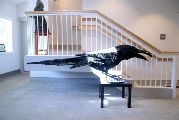 "Patricia Warfield of Black Rock sculpture "" Crow"" is part of a show at the Bartlett Arboretum in Stamford, Conn. on Friday July 6, 2012. The show includes both a outdoor sculpture show and indoor exhibit called "" Flower Power"" at the Photo: Dru Nadler / Stamford Advocate Freelance"