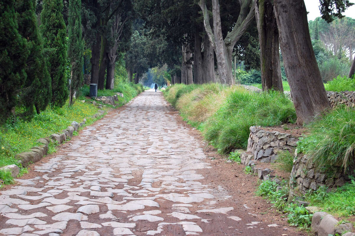 The ancient paving blocks of the Appian Way can be seen in a park just outside of central Rome.