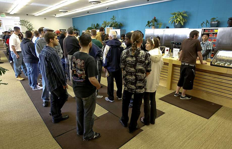 Dozens of patients line up to purchased medicinal Marijuana at the Harborside Health Center in Oakland, Calif. on Tuesday Apr. 20, 2010. The company is dispensary of the medicinal drug. Photo: Michael Macor, The Chronicle