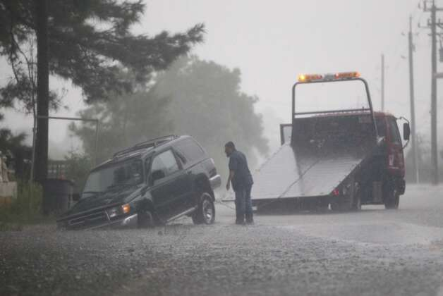 Roads swollen with rains makes for dangerous travel in Houston Thursday, July 12, 2012. Photo: Michael Paulsen / Houston Chronicle
