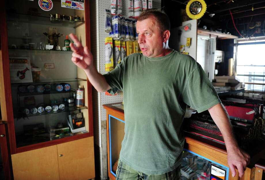 John Szyszka, owner of Seaview Avenue Fish, fears the bait and tackle shop he has operated for seven years in Bridgeport will not survive competition from Bass Pro Shops, the anchor tenant for the city's Steel Point redevelopment.  He is making plans to open a small, seasonal grill and bar on his waterfront property. Photo: Autumn Driscoll / Connecticut Post