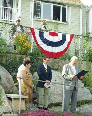 Norwalk Mayor Richard Moccia reads a proclamation for the rededication of the Flax Hill Cannonball Monument on Wednesday. Maria and Jorge Cruz of Norwalk helped preserve the monument. Photo: Meg Barone