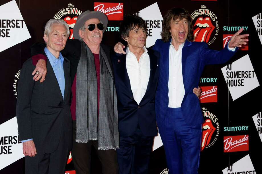 From left, Charlie Watts, Keith Richards, Ronnie Wood and Mick Jagger, from the British Rock band The Rolling Stones, arrive at a central London venue, to mark the 50th anniversary of the Rolling Stones first performance, Thursday, July 12, 2012. (AP Photo/Jonathan Short) Photo: Jonathan Short