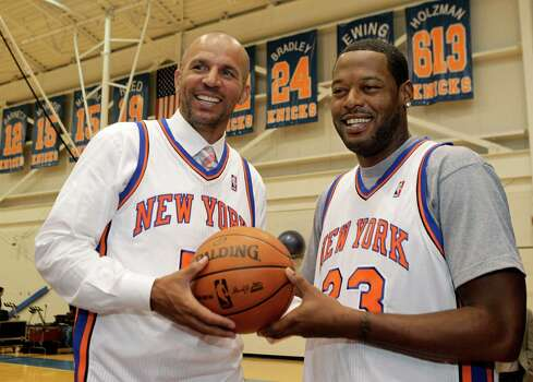 Jason Kidd, left, and Marcus Camby pose for a photograph following a news conference to introduce the New York Knicks newest additions at the team's NBA basketball training facility in Tarrytown, N.Y., Thursday, July 12, 2012.  This is Camby's second stint as a member of the Knicks. (AP Photo/Kathy Willens) Photo: Kathy Willens, Associated Press / AP