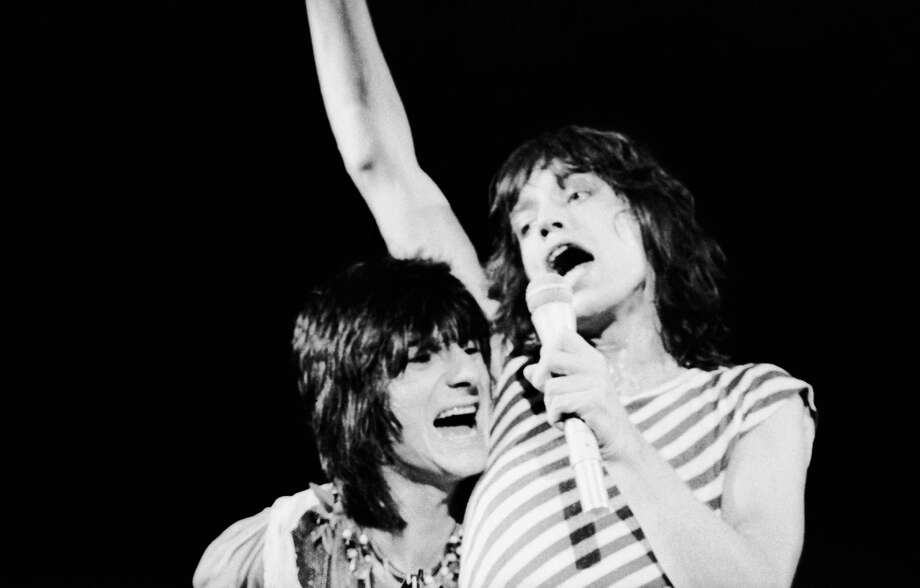 If you aren't the lead singer, you might have to get closer to Mick Jagger's armpit than you like. From a May 1976 concert.  Photo: John Minihan, Getty / 2006 Getty Images