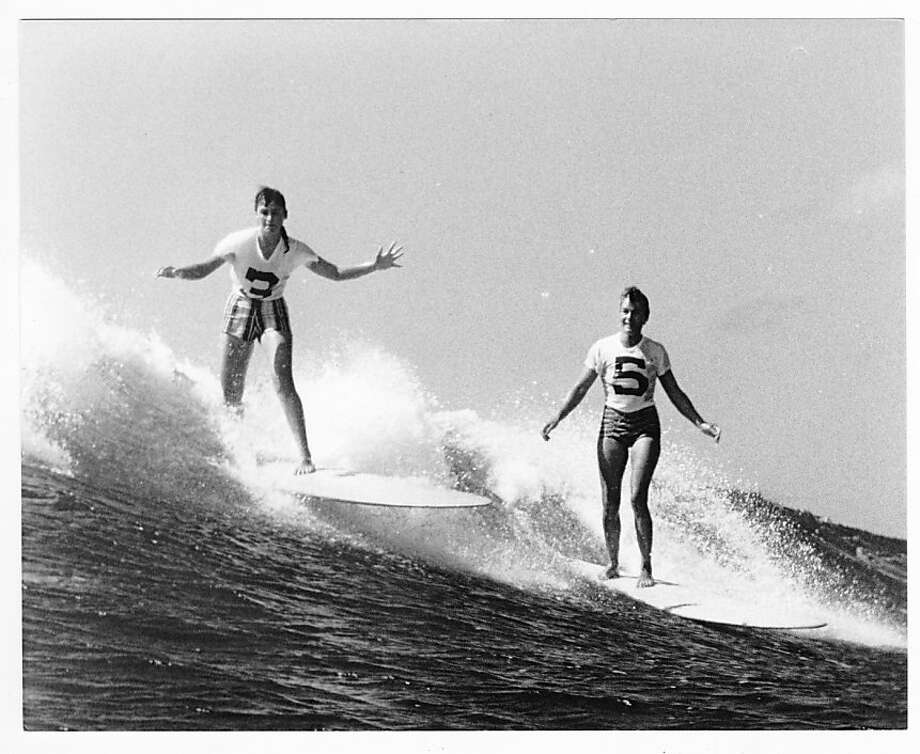 "Keala Stibbard, then a teenager, and Marge Calhoun wear contest jerseys while competing in the 1958 Makaha International Surfing Championships put on by the Waikiki Surf Club, which Calhoun went on to win. This photo and the legacy of women surfers are part of ""Boardshorts: A Perfect Fit"" at the Honolulu Museum of Art. Stibbard later moved to Northern California, where in 1979 she co-founded the Pu Pu 'O Hawai'i Outrigger Canoe Club, based in Santa Cruz and Los Gatos; she remains a competitive paddler. Photo: Courtesy Clarence Maki Family"
