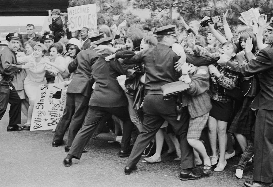 Fans were really fans back then. Policemen holding back Rolling Stones fans in New York where the band was on tour in June 1964. Photo: William Lovelace, Getty / 2006 Getty Images
