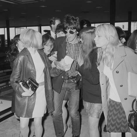 A very young -- and cool -- Keith Richards draws fans at the London Airport in June 1966.  Photo: Ted West, Getty / 2006 Getty Images