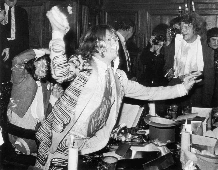 Boys will boys. The Rolling Stones start a custard pie fight at a fancy banquet room in England in December 1968. Good fun, perhaps. They were also promoting 'Beggars' Banquet'. Photo: Douglas Miller, Getty / 2004 Getty Images