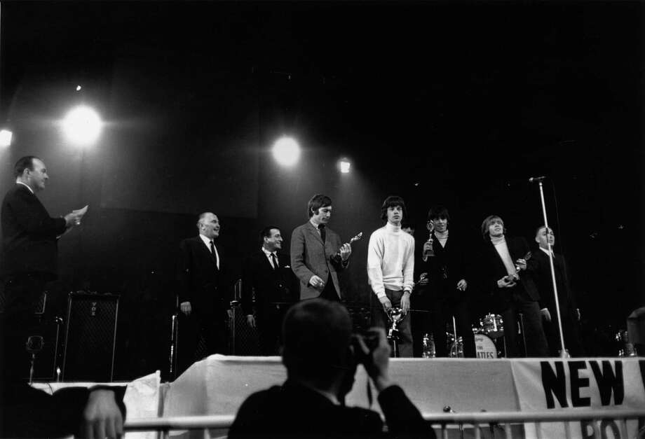 The Rolling Stones receiving awards at the NME Poll Winners Concert at Wembley, London, in 1965 Not to worry, mate. This isn't a career highlight. Photo: Express, Getty / Hulton Archive