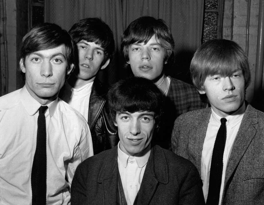 Back in the day, they wore ties and were called a rhythm and blues group. Here they are in December 1963:  from left to right; Charlie Watts, Keith Richards, Bill Wyman (front), Mick Jagger and Brian Jones . Photo: Chris Ware, Getty / Hulton Archive