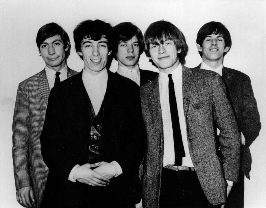 A few months later in April 1964, and the boys are still wearing ties. From left to right, drummer Charlie Watts, bass guitarist Bill Wyman, singer Mick Jagger, guitarist Brian Jones (1942 - 1969) and guitarist Keith Richards. Photo: Keystone Features, Getty / Hulton Archive