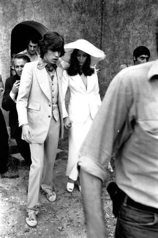 In the 1970s, Mick Jagger and Bianca Jagger were the world's coolest couple. Here they are after their wedding ceremony in St Tropez in May 1971. Photo: Express Newspapers, Getty / Hulton Archive