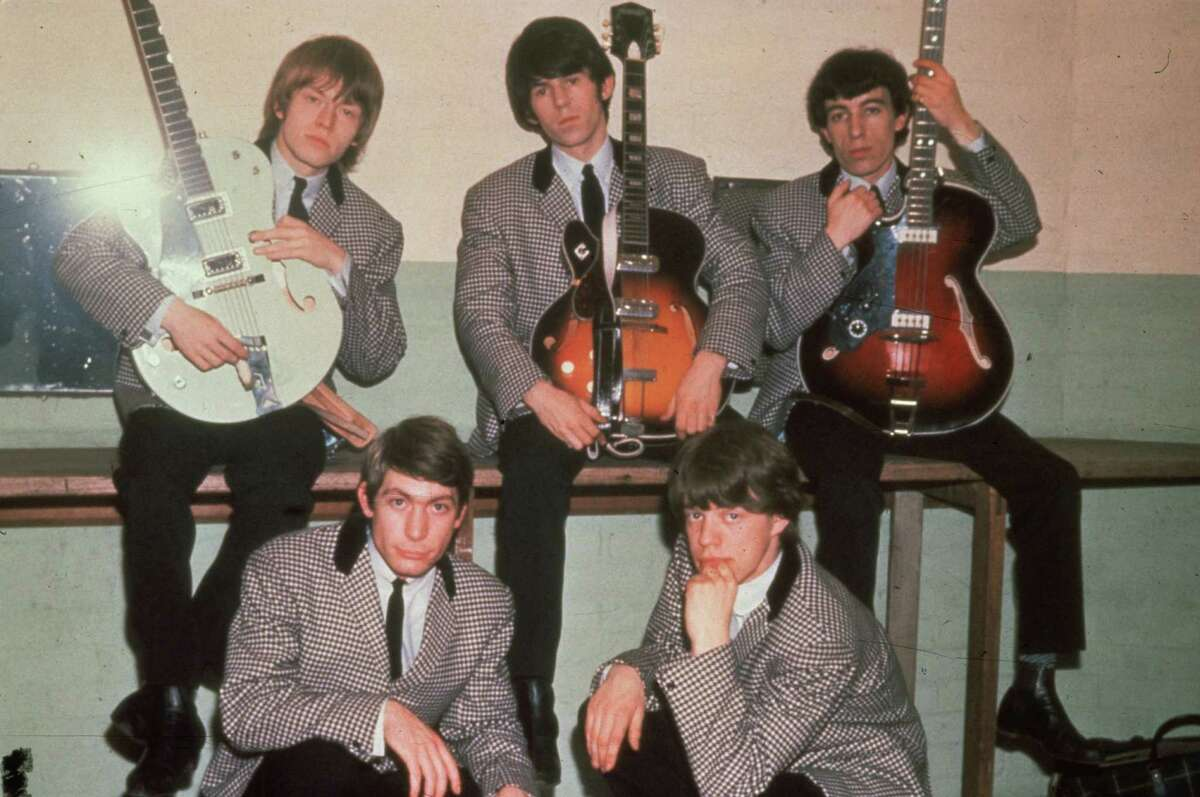 Nice suits. Just back from the prom, The Rolling Stones in 1964: drummer Charlie Watts, frontman Mick Jagger, guitarists Keith Richards and Brian Jones and bassist Bill Wyman.