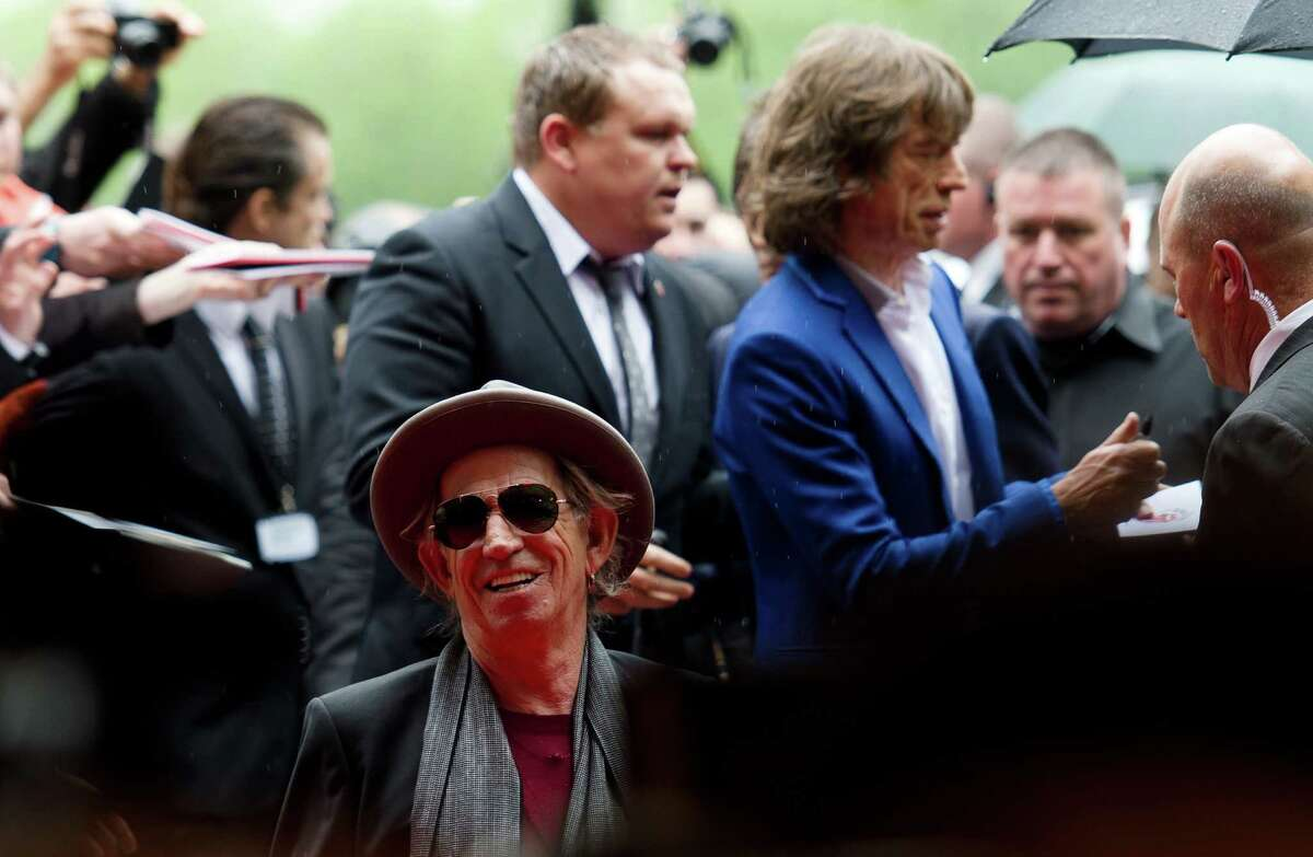 The late Keith Richards and Mick Jagger arrive at Somerset House in central London ahead of a party to celebrate the launch of a book