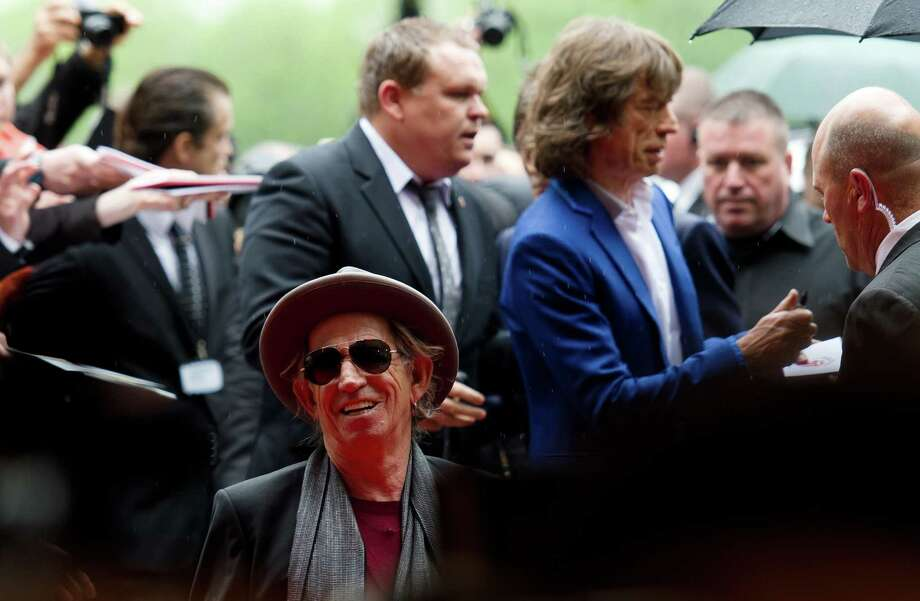 """The late Keith Richards and Mick Jagger arrive at Somerset House in central London ahead of a party to celebrate the launch of a book """"Rolling Stones 50"""" and a photographic exhibition on Thursday. No wait, sorry. Keith Richards is still alive. Who knew? Or could tell? Photo: LEON NEAL, Getty / 2012 AFP"""