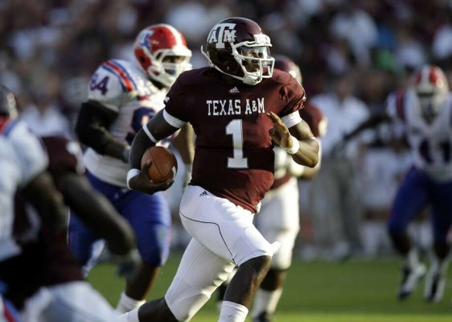In 2010, Texas A&M quarterback Jerrod Johnson and the Aggies sported a maroon seam down the legs of their home uniforms.  (David J. Phillip / AP)