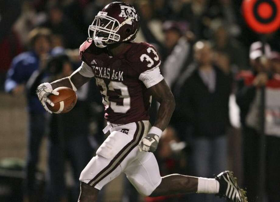 In 2009, the home uniform for Christine Michael and the Aggies had a grey stripe laid over a wide maroon stripe on the pants.  (TOM REEL / SAN ANTONIO EXPRESS-NEWS)