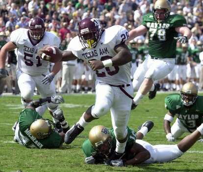 In 2000, running back Joe Weber and the Aggies were in all white unis at Waco.  (Duane A. Laverty / Waco Tribune-Herald)