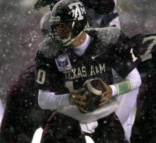 At the snowy 2000 Independence Bowl, quarter back Mark Farris and the Aggies broke out the all-maroon look against Mississippi State. ( EDWARD A. ORNELAS / Staff)