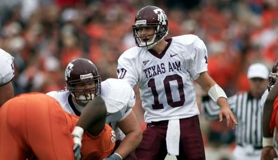 The 2000 road uniforms were white jerseys with no stripes on the maroon pants.  (File / Associated Press)