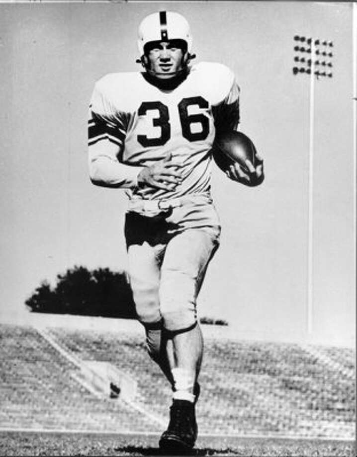 In 1950, A&M All-American running back Bob Smith ran for 1,302 yards and 14 touchdowns with the basic uniform of his day, sans facemask.  (Express-News file photo)