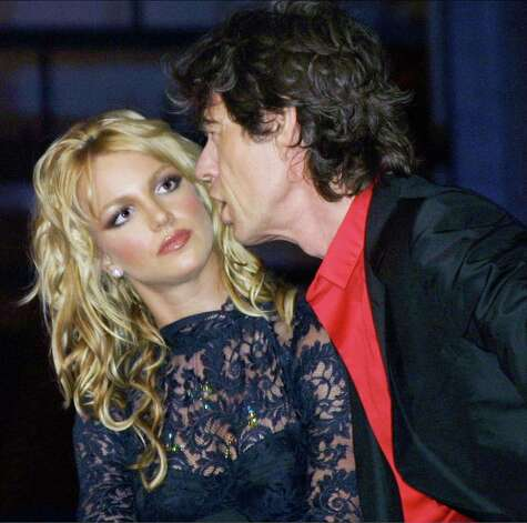 In September 2001, Jagger was either talking to Britney Spears or getting really close to a wax figure of the pop star. You decide.  Photo: George De Sota, Getty / Getty Images North America