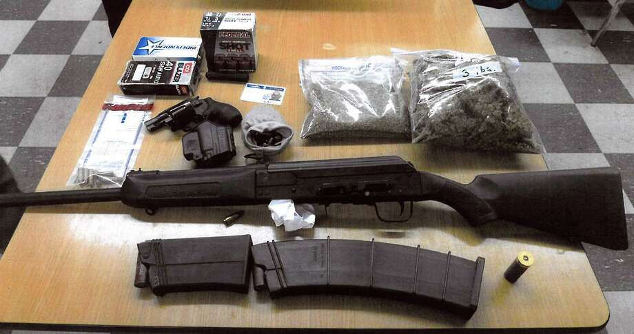 Police seized more than 35 pounds of marijuana and a Russian-made assault rifle following the arrest of a Stratford man Wednesday. Photo: Bridgeport Police, Contributed Photo / Connecticut Post Contributed