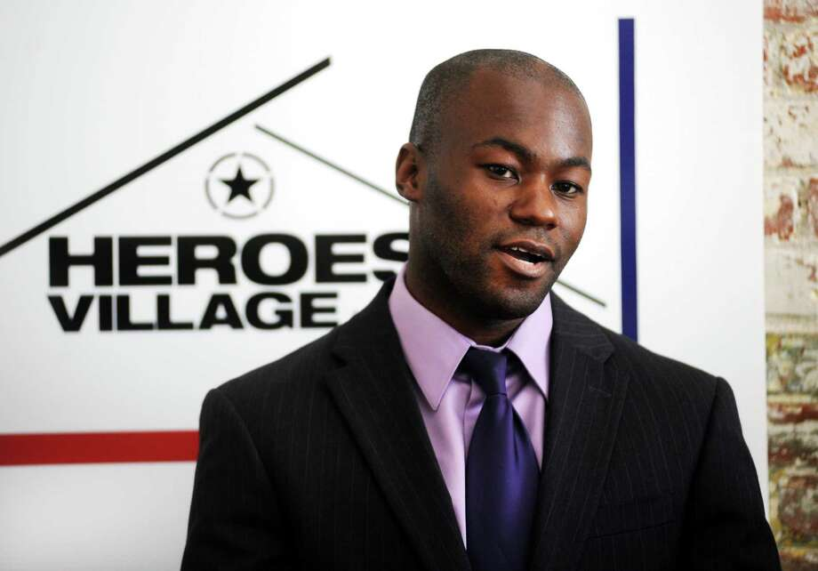 Howard Jean-denis, a U.S.Army veteran and the project manager at Heroes Village LLC speaks at a press conference at the office of Heroes Village LLC in Bridgeport, Conn. on Thursday July 12, 2012. The state's STEP UP job training and employment program is helping Heroes Village LLC to hire military veterans and carry out its mission to provide affordable housing for other local veterans. Photo: Cathy Zuraw / Connecticut Post