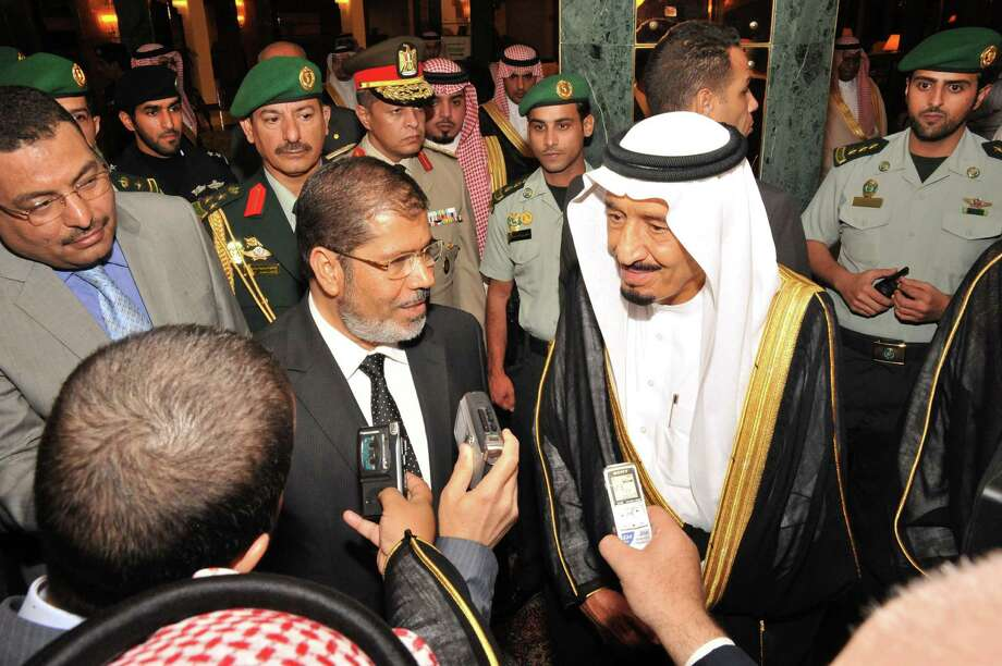 "In this Wednesday, July 11, 2012 photo released by the Egyptian Presidency, Egyptian President, Mohammed Morsi, center left,  and Saudi Crown Prince Salman bin Abdulaziz Al Saud, center right, speak to journalists at the al-Salam palace in Jeddah, Saudi Arabia. Morsi has said his administration has no plans to ""export"" Egypt's revolution, an implicit reassurance to Saudi Arabia and its Gulf allies, who have been nervous over the possibility of Arab Spring revolts reaching their shores. Photo: AP"