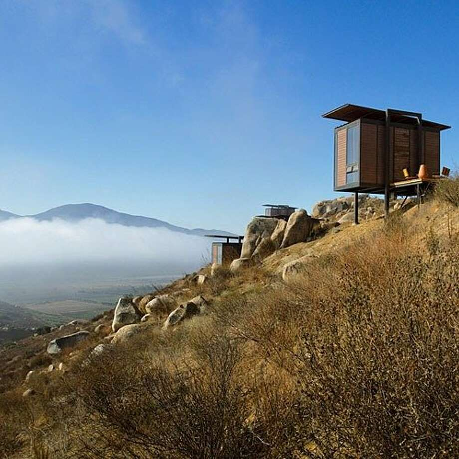 Hotel Endémico, Baja, Mexico:  Hotel Endémico's modular bungalows are a sleek departure from Baja's  über-resorts. Scattered across a hillside in Mexico's Valle de Guadalupe, the 20 cabins sit in the heart of an upcoming wine country, where the warm, dry climate produces fascinating wines like Tempranillo. Sip one by the kiva on your private terrace, strategically placed to soak up the views. That is, when you're not at the pool, taking a cooking class, or learning how to make your own wine. From $200 U.S.; 90 minutes south of San Diego; call the hotel to arrange car service; encuentroguadalupe.com