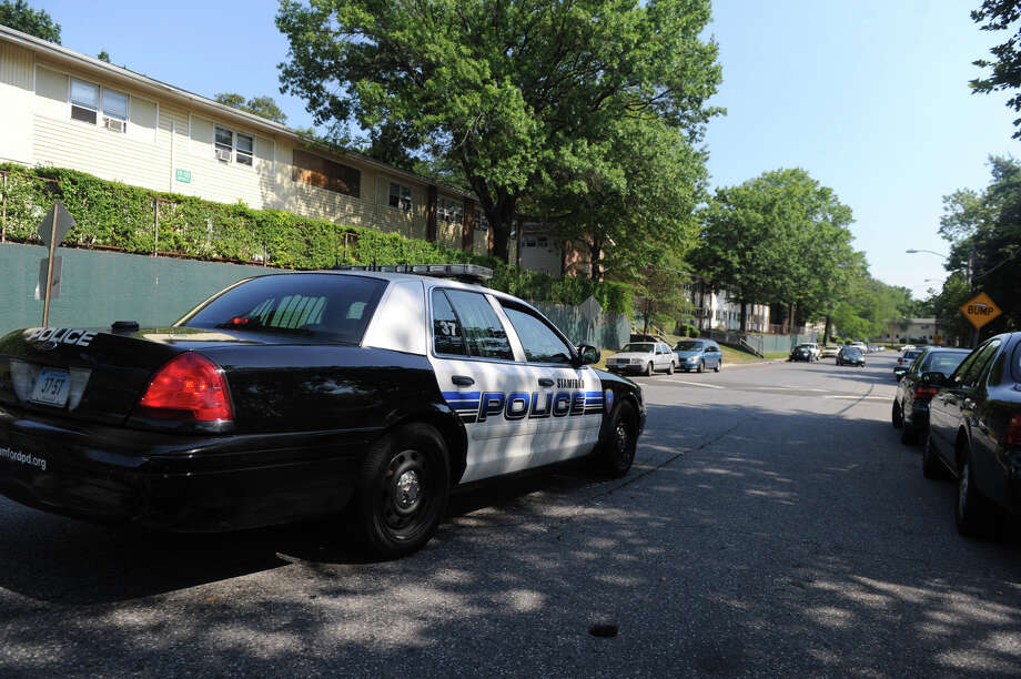 The Stamford Police are increasing patrols on Custer Street in Stamford, Conn., July 12, 2012. The added patrols are a result of a spree of shootings within the past week. Photo: Keelin Daly / Stamford Advocate