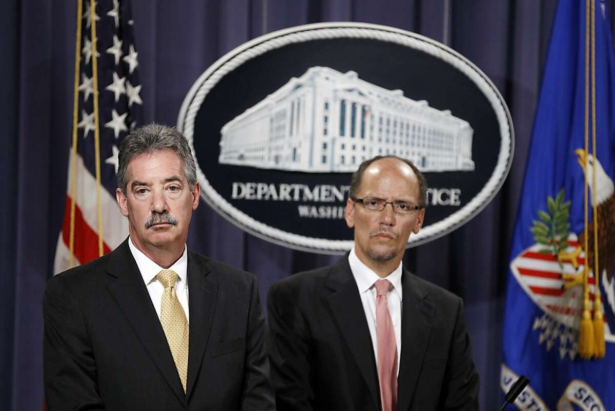Deputy Attorney General James M. Cole, left, and Assistant Attorney General for the Civil Rights Division Thomas E. Perez take part in a news conference at the Justice Department in Washington, Thursday, July 12, 2012, to announce that Wells Fargo Bank will pay at least $175 million to settle accusations that it discriminated against African-American and Hispanic borrowers in violation of fair-lending laws. (AP Photo/Haraz N. Ghanbari)