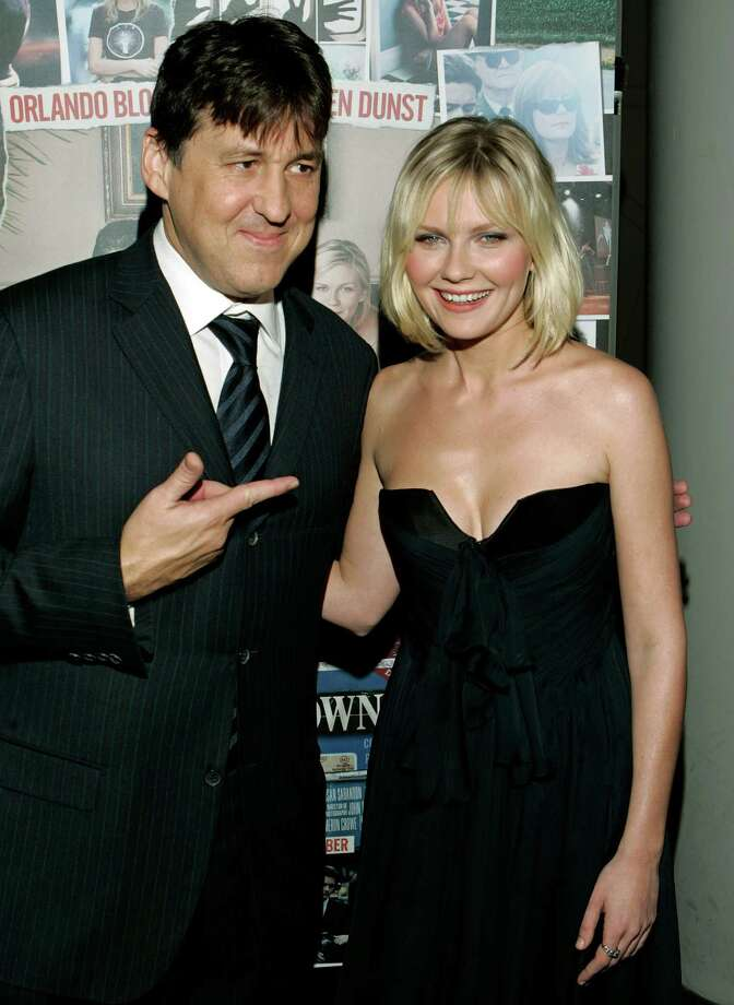 Writer, director and producer Cameron Crowe, points to co-star Kirsten Dunst during the arrivals for the New York premiere of the film Elizabethtown, Monday, Oct. 10, 2005.   (AP Photo/Stuart Ramson) Photo: STUART RAMSON / AP