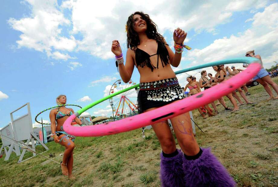 Bari Nicole Robinson, right, and Janelle Butkevich hula hoop to the sounds of Inspired Flight as Camp Bisco 11 kicks off in Pattersonville NY Thurssday  July 12, 2012. (Michael P. Farrell/Times Union) Photo: Michael P. Farrell