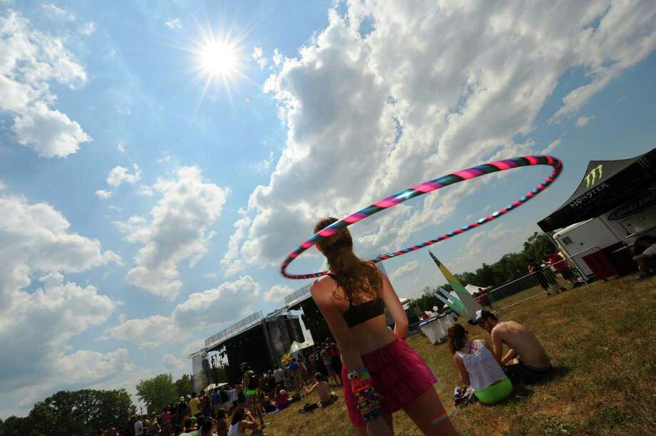 Ashley Jones of Troy hula hoops to the sounds of Inspired Flight as Camp Bisco 11 kicks off in Pattersonville NY Thurssday  July 12, 2012. (Michael P. Farrell/Times Union) Photo: Michael P. Farrell