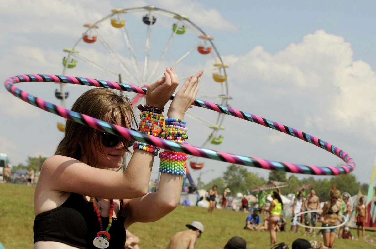 Ashley Jones of Troy hula hoops to the sounds of Inspired Flight as Camp Bisco 11 kicks off in Pattersonville NY Thurssday July 12, 2012. (Michael P. Farrell/Times Union)