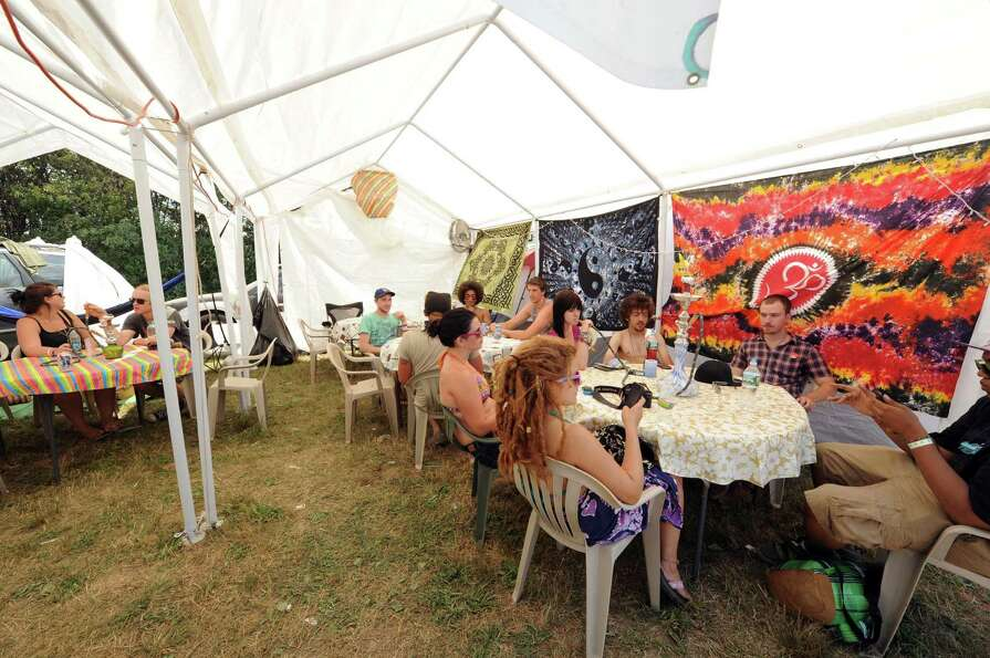Customers enjoy the Spiritual Haze Hookah Cafe as Camp Bisco 11 kicks off in Pattersonville NY Thurs