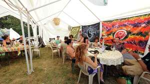 Customers enjoy the Spiritual Haze Hookah Cafe as Camp Bisco 11 kicks off in Pattersonville NY Thurssday  July 12, 2012. (Michael P. Farrell/Times Union)