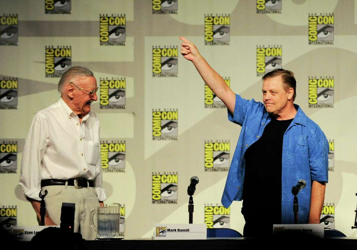 Actor Mark Hamill, right, points to the crowd as Stan Lee, right, looks on at the start of the Stan Lee's World of Heroes panel on the first day of Comic-Con convention held at the San Diego Convention Center on Thursday July 12, 2012, in San Diego. (Photo by Denis Poroy/Invision/AP)