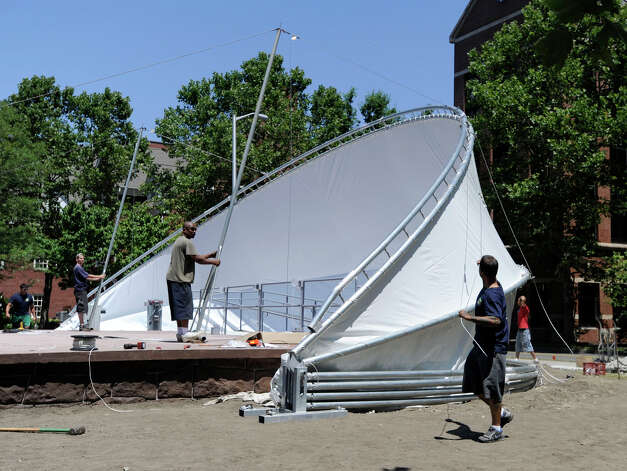 Workers from Durkins Inc. in Danbury erect a new band shell at the CityCenter Danbury Green Tuesday, July 10, 2012. The previous one was damaged by the October snowstorm. Photo: Carol Kaliff / The News-Times