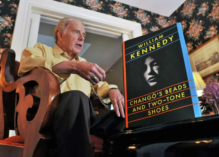 "Author William Kennedy with a copy of his new novel ""Chango's Beads and Two-Tone Shoes"", his first in a decade, inside his Albany townhouse Wednesday Sept. 14, 2011.  (John Carl D'Annibale / Times Union) Photo: John Carl D'Annibale / 00014624A"