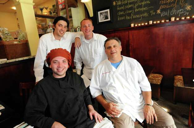 Staff at Mio Posto restaurant on Friday, July 6, 2012, in Saratoga Springs, N.Y. Clockwise from bottom left are suos chef Jonny Adams, servers Michael Lanci and Jared Cardon, and chef Danny Petrosino. (Cindy Schultz / Times Union) Photo: Cindy Schultz / 00018370A