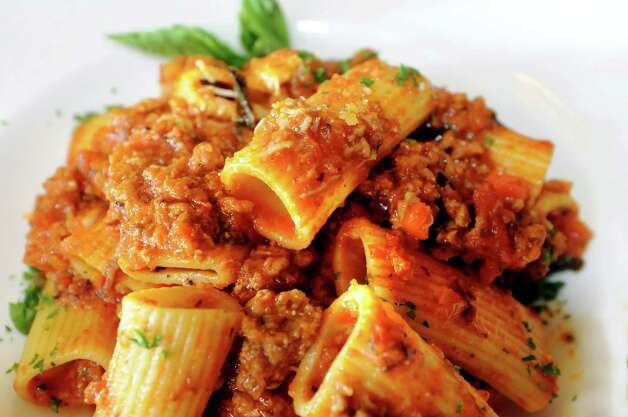 Fresh rigatoni with a meaty Bolognese on Friday, July 6, 2012, at Mio Posto in Saratoga Springs, N.Y. (Cindy Schultz / Times Union) Photo: Cindy Schultz / 00018370A
