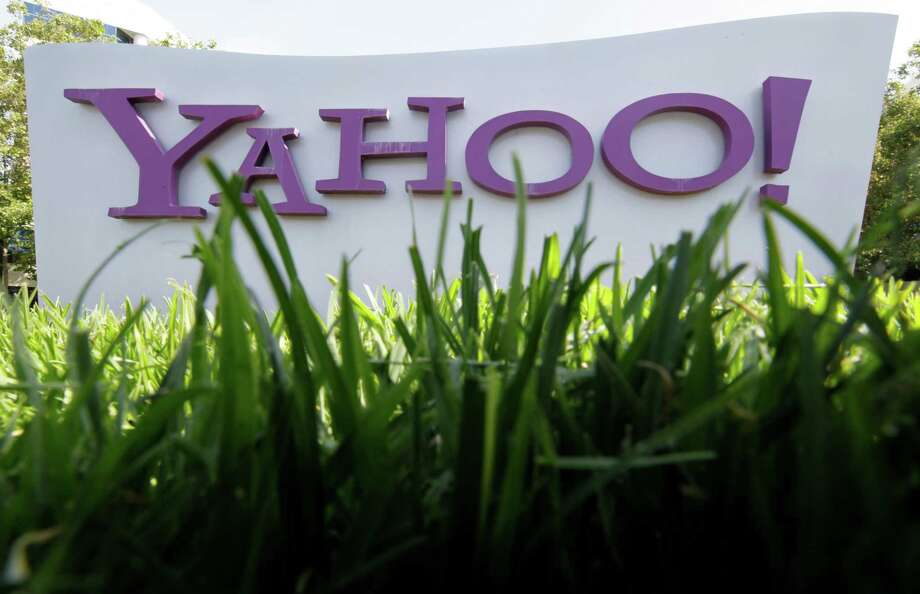 FILE - In this May 20, 2012 file photo, a Yahoo sign stands outside the company's offices in Santa Clara, Calif. Yahoo's restless shareholders let interim CEO Ross Levinsohn know that they won't give him much time to turn the company around if he gets the job on a permanent basis at Yahoo's annual shareholders meeting Thursday. July 12, 2012. Photo: AP