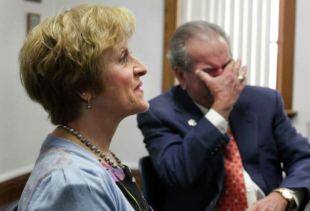 Bob Elizondo, right, holds back tears as his wife Anna Elizondo recalls a story about their son Michael Elizondo who died earlier this year.  The Elizondos are donating $1 million to Central Catholic High School in memory of their son.  The school's new library will carry Michael's name. Thursday, July 12, 2012. Photo: BOB OWEN, San Antonio Express-News / © 2012 San Antonio Express-News